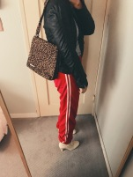 vintage track pants, wrap shirt, leather jacket, leopard print bag & boots. entire outfit thrifted.